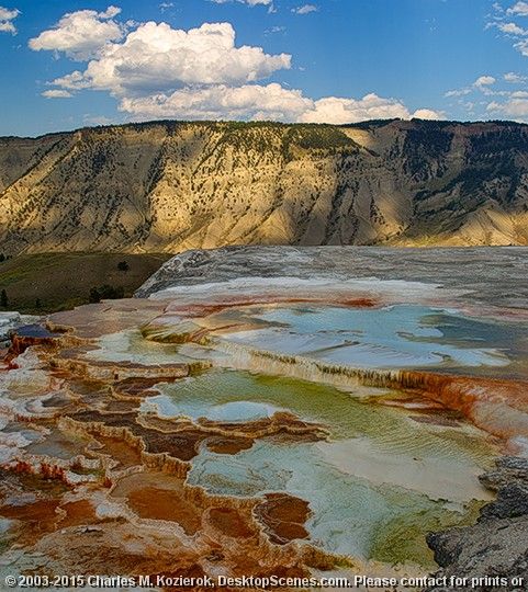 Main Terrace Pastels The main terrace at Mammoth Hot Springs is called... wait for it.. the Main Terrace. :) It is arguably the most beautiful formation at Mammoth, consisting of a set of cascading, rippling terraces of travertine, with bacterial mats and other minerals creating a spectrum of colors from orange to blue and green.<br> <br> Here Mount Everts is once again in the background, along with some nicely cooperative puffy clouds. :)