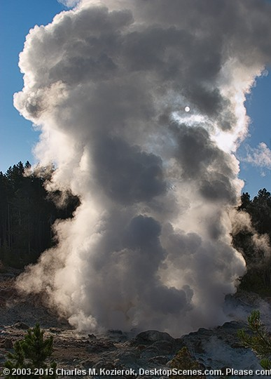 """Sunlit Steamboat Geyser Steamboat Geyser is one of the larger and more interesting geysers at the Norris Basin. It's not one of the """"predictable"""" geysers, like Old Faithful; hours, days or even years can pass between its eruptions. When it does erupt, water can reach a height of several hundred feet, making it one of the biggest geysers in the world. Even when not erupting, Steamboat often vents large quantities of steam, which is likely the source of its name.<br> <br> On this crisp morning I was able to take this interesting shot of the geyser's crater with the steam billowing up, backlit by the sun (visible as a small white circle on the right hand side.)"""